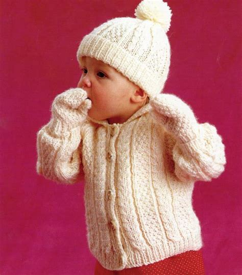 aran knit hats free patterns knitting pattern for baby s aran cable jacket bobble hat