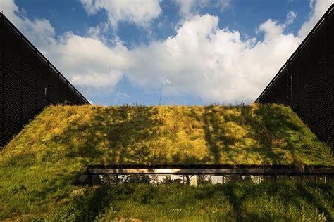 mont de marsan s timber slatted volumes float out from a grassy hillside in inhabitat