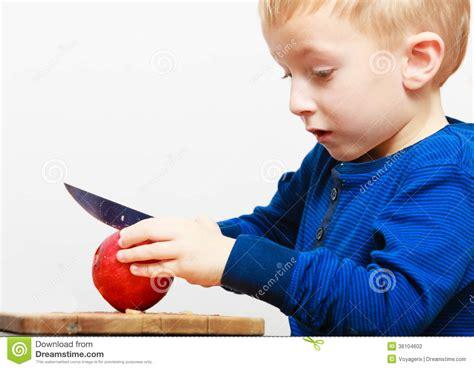 Childrens Kitchen Knives boy child kid preschooler with knife cutting fruit apple