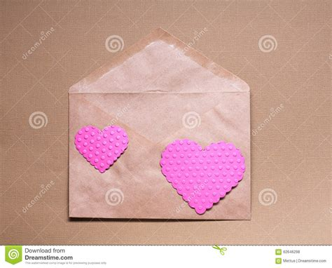 pink craft paper two pink hearts on craft paper envelop stock photo image