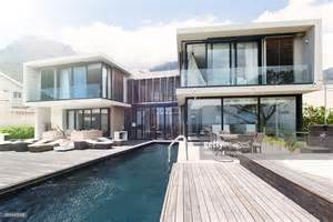 modern house with pool modern house with large patio and swimming pool stock