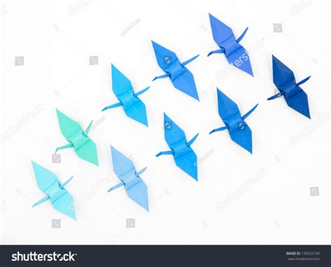 blue origami paper blue origami paper cranes on white stock photo 135525749