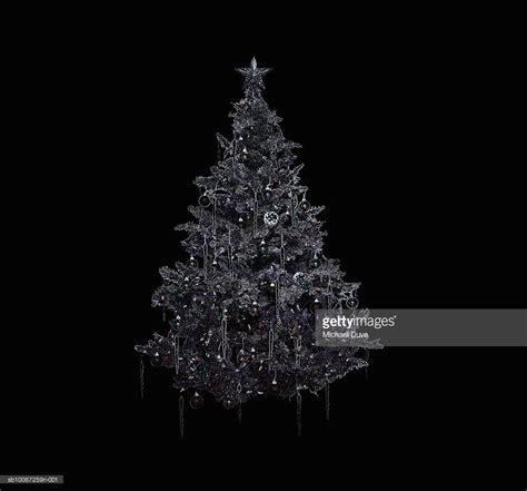 tree on black background silver tree on black background stock photo