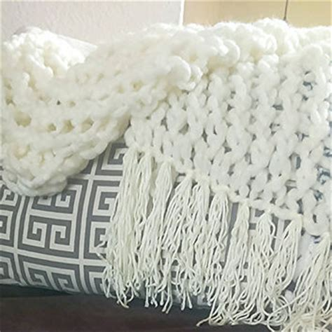 arm knitting with thin yarn arm knit blanket with fringe light from the snugglery the