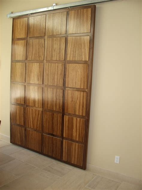 hanging door walnut and zebra wood hanging door eclectic interior