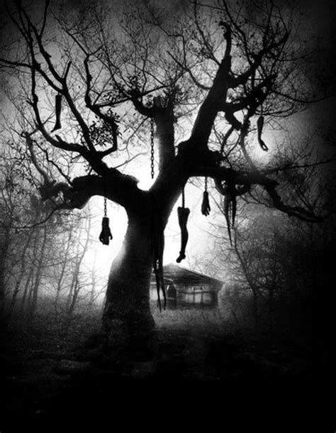 tree horror creepy tree with parts hanging from it haunted
