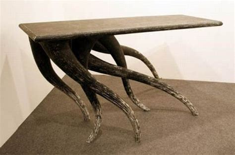 designer table coffee table with dynamic legs digsdigs