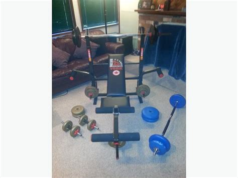 Folding Bench Press Weight Set by York Bench Press Curl Bar Dumbell Complete Weight