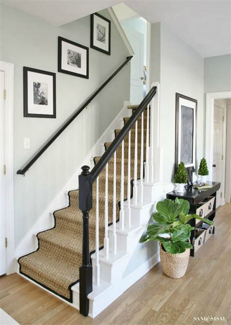 black staircase painted staircase makeover with seagrass stair runner