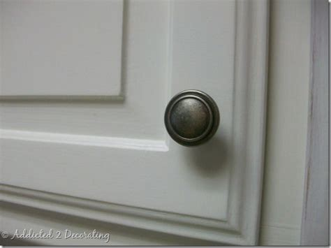 where to place knobs on kitchen cabinet doors change your cabinet hardware from pulls to handles