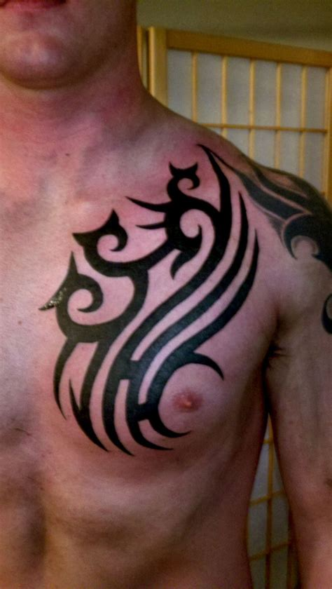 fine black ink tribal chest tattoo tattooshunt com