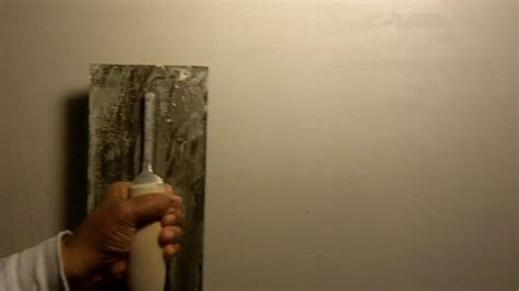 skim plastering how to smooth out plaster with a skim coat see drill