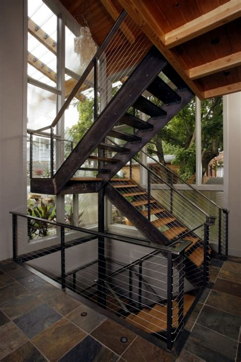 A Frame Style House the modern steel staircase inside and outside in the