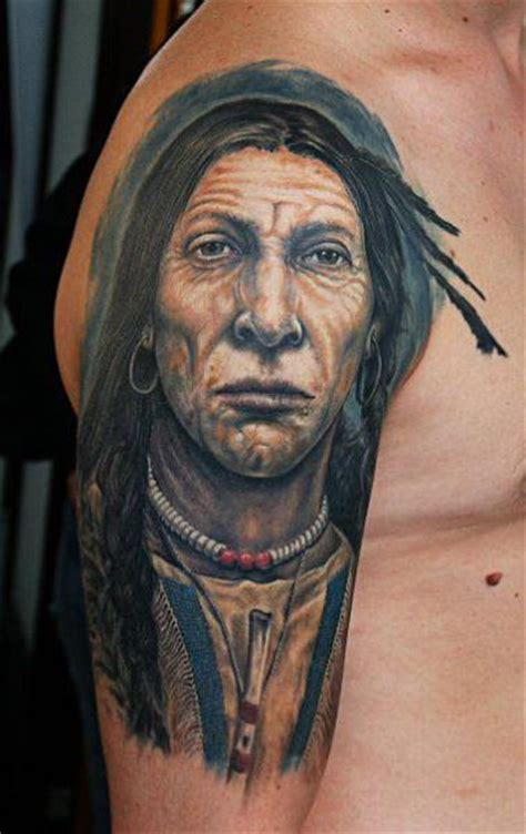 shoulder arm portrait realistic indian tattoo by roman