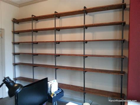 wood plank shelves industrial pipe shelving industrial chic concrete and