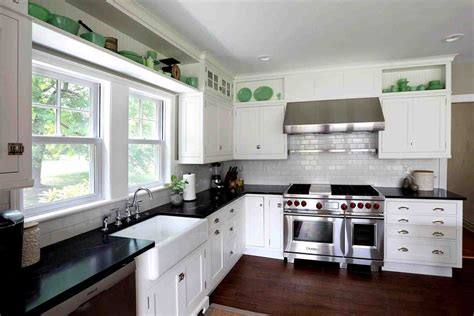 white kitchen cabinets black granite countertops antique white kitchen cabinets with black granite