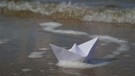 origami boat that floats origami paper boat floats in water stock footage