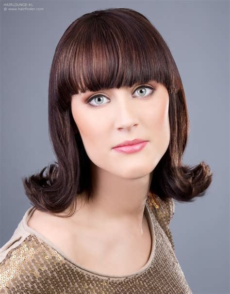 hairstyles with 60s flip hairstyle with an outward roll of the hair