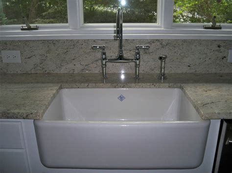 traditional kitchen sinks rohl shaw sink and bridge faucet