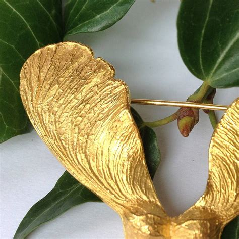 gold seed gold sycamore seed brooch by beth slayden jewellery