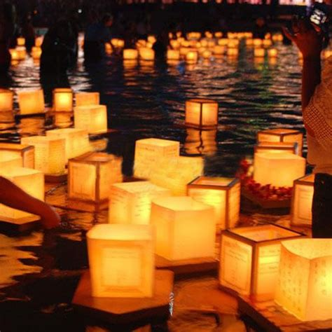 water and floating candles square paper wishing floating river candle