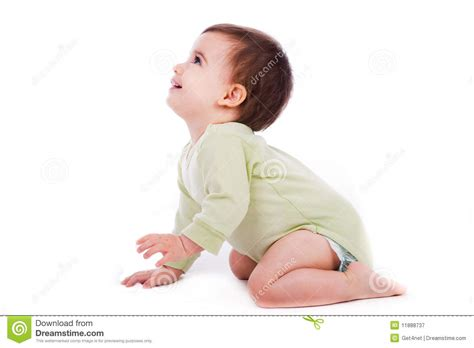 the of the baby sat side pose of baby sitting and looking up stock image