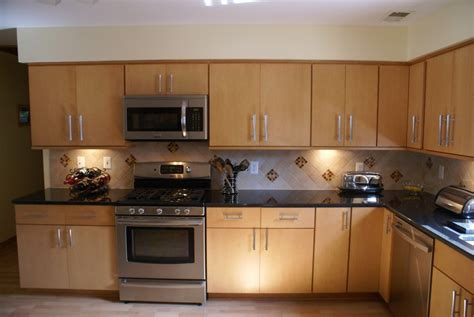 adding cabinet lighting small kitchen project adding an island 5 striking kitchen