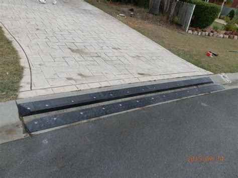 concrete rubber st car bottoming out these heavy duty rubber driveway rs
