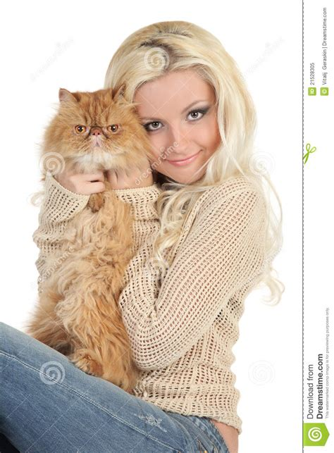 beautiful blonde with a fluffy persian cat royalty free