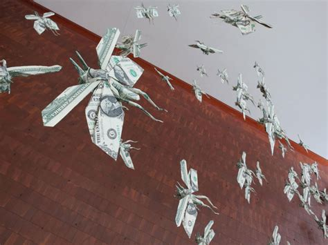 origami flying sipho mabona s swarm of flying money origami locusts yatzer