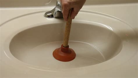 plunger kitchen sink unplugging a sink with a small plunger stock footage