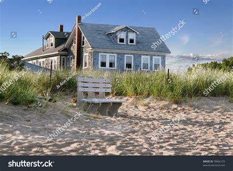Farmhouse Style House new england beach cottage overlooking dunes stock photo