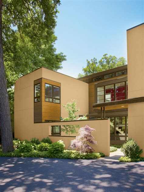 best exterior house paint colors for resale home with modern architecture with pale gold and grey