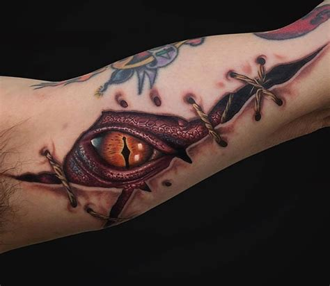 ripped skin smaug dragon best tattoo design ideas