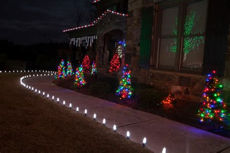 cascading outdoor lights glamorous pre lit trees in landscape traditional