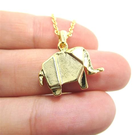 origami necklace and charms origami abstract elephant shaped charm necklace in gold
