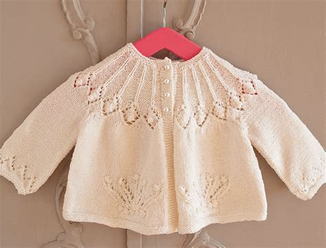 knitting motifs for babies and this exquisite cardigan pattern was issued by patons