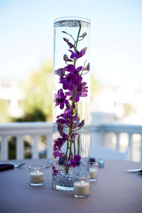 purple water centerpieces water centerpieces and flower on