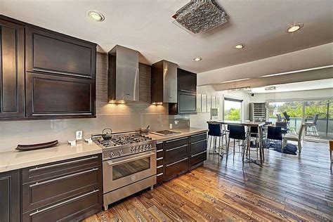 contemporary kitchen with breakfast bar amp handscraped wood
