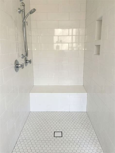 Large White Tiles For Bathroom by Large White Subway Tile Shower Surround With Hexagon Floor