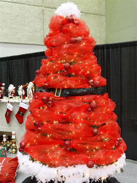 santa themed trees decorating a santa themed tree themed