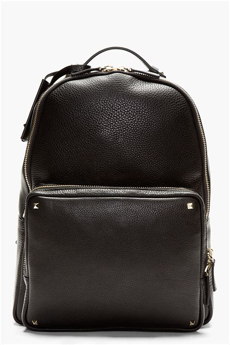 black leather backpacks valentino black pebbled leather backpack in black for lyst