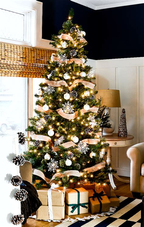 tree with pine cones tree with burlap ribbon pine cones it all
