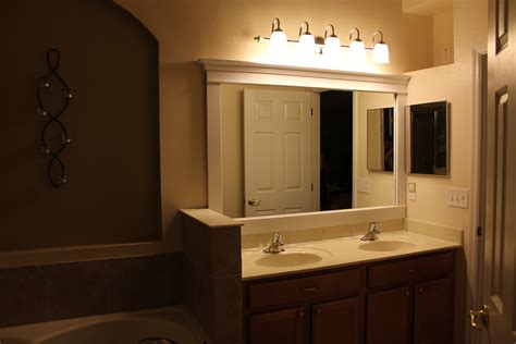 above mirror lighting bathrooms pinspiration diy framed mirror the gilbertson family