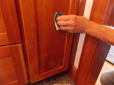 cleaning kitchen cabinet doors how to clean sticky kitchen cabinet doors how to paint