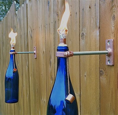 wine bottle tiki torch 221 upcycling ideas that will