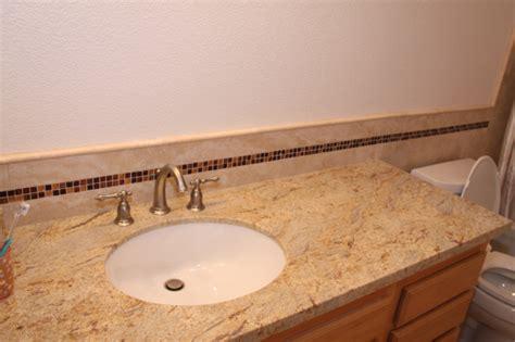 Modern Backsplash Tiles For Kitchen mediterranean style bathroom with river gold granite