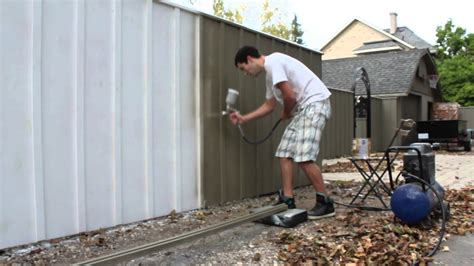spray painting furniture with compressor painting a fence with an air spray paint gun solid