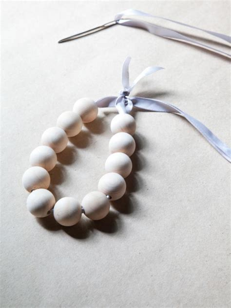 bead window how to make a wooden bead ornament hgtv
