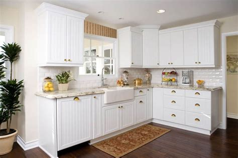 Kitchen Cabinet Refacing l shaped kitchen using white beadboard cabinet doors and